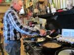 Bo Cribbs prepares a feast, outside Santa Rosa, NM